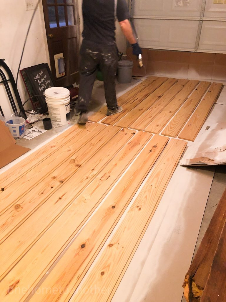 shiplap boards are laid out to begin the painting with our paint sprayer.