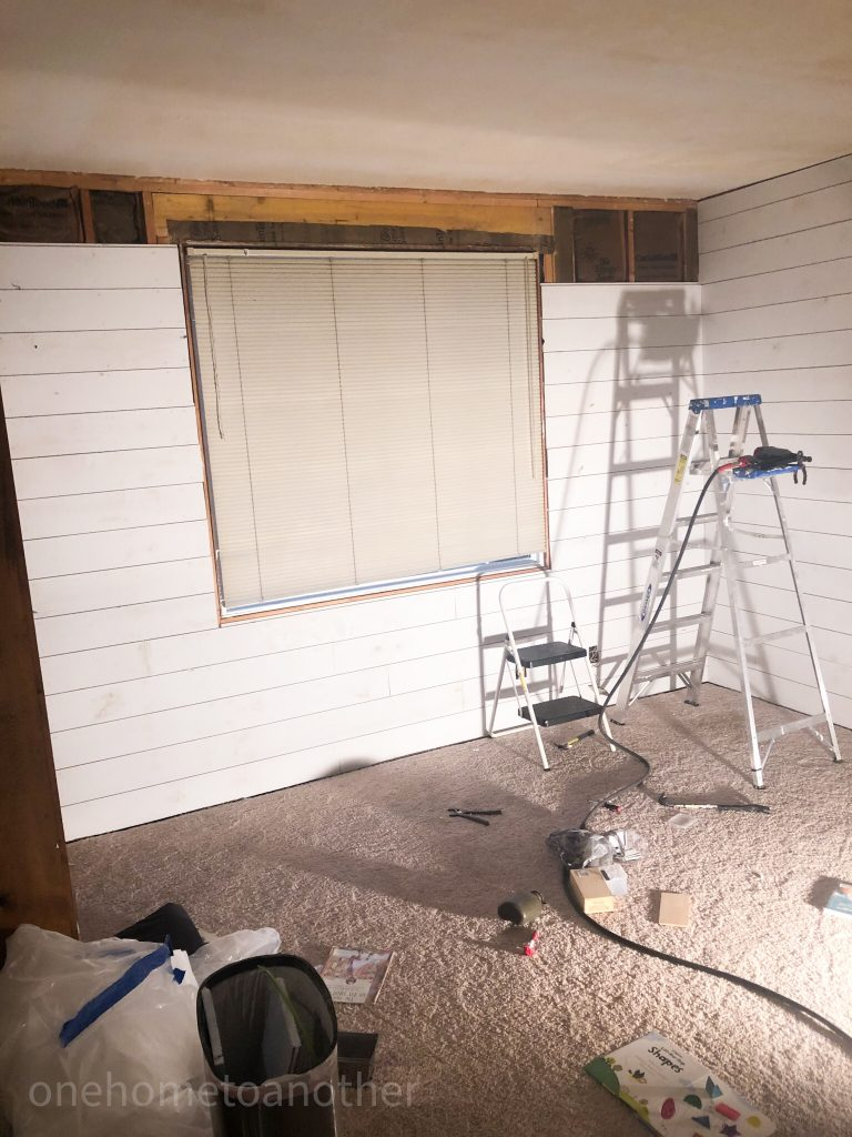 hanging shiplap around the large picture window