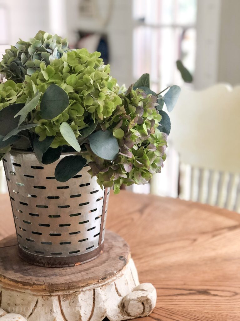 olive bucket with dried hydrangeas